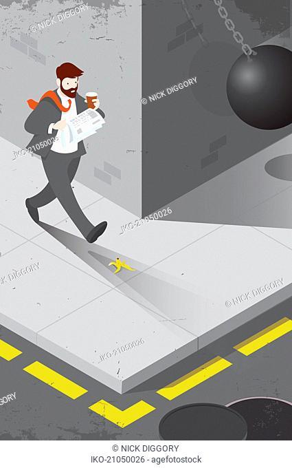 Distracted businessman unaware of hazards in path