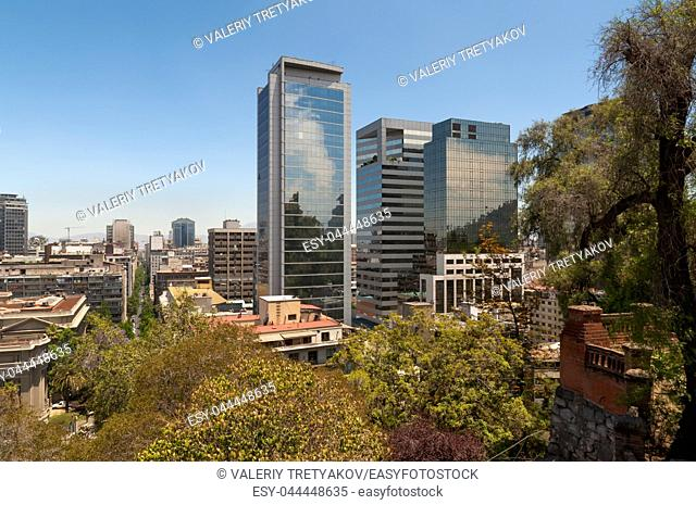 View of the skyline of Santiago, Chile with a park visible shot from Cerro Santa Lucia
