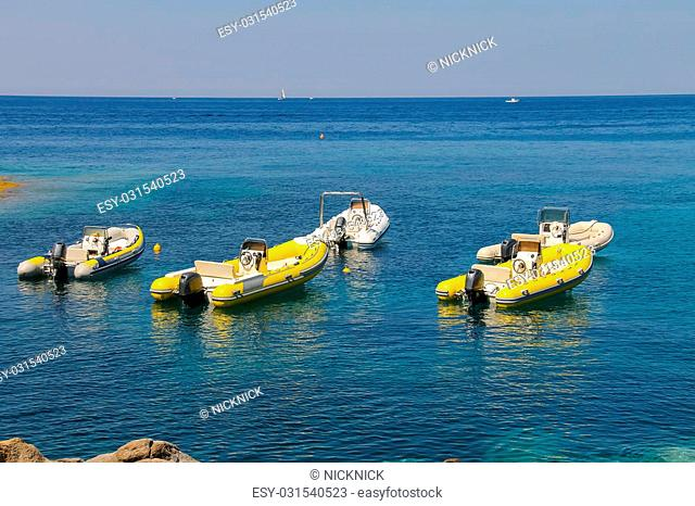 Anchored motorboats in waters of Tyrrhenian Sea, Sant Andreas on Elba Island, Italy