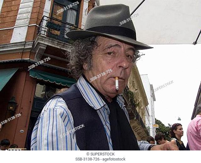 Mature man smoking a cigarette, Buenos Aires, Argentina