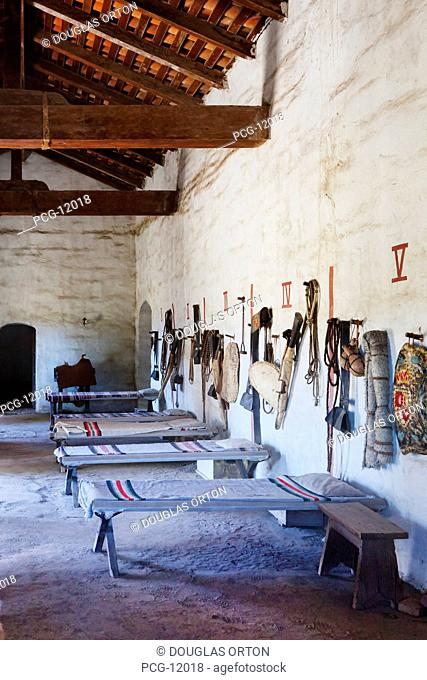 Bunkhouse or sleeping room with cots and riding tack at Mission La Purisima State Historic Park, Lompoc, California, Founded in 1787
