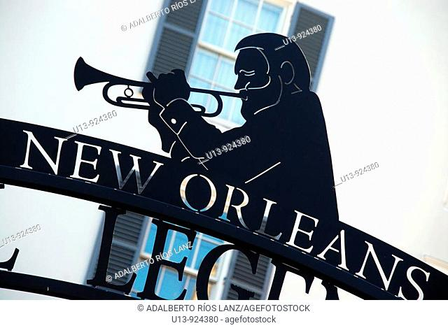 Jazz musician silhouette at Cafe Beignet, French Quarter, New Orleans, Louisiana, USA