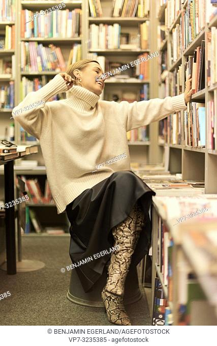fashionable German blogger woman in library, Munich, Germany