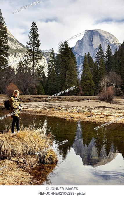 Woman at mountain lake