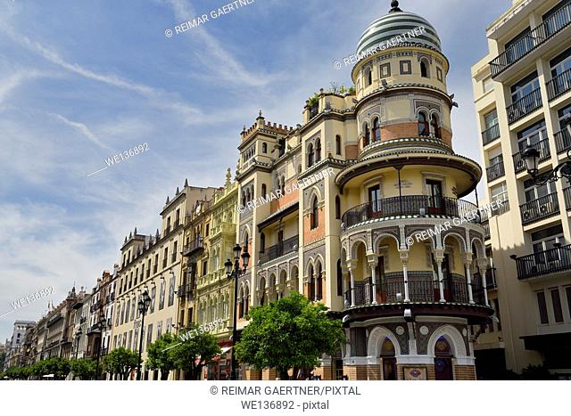The Adriatic building at the end of a row of historic architecture on Consititution Avenue in Seville Spain
