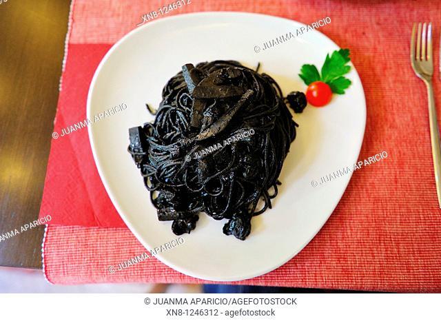 Pasta dish with squid ink sauce