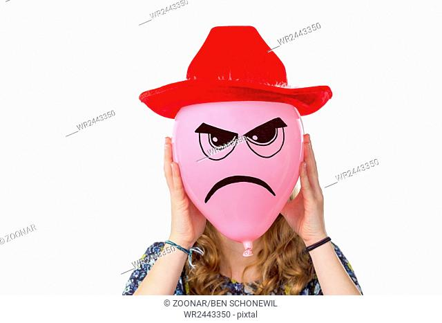 Girl holding pink balloon with angry face and red