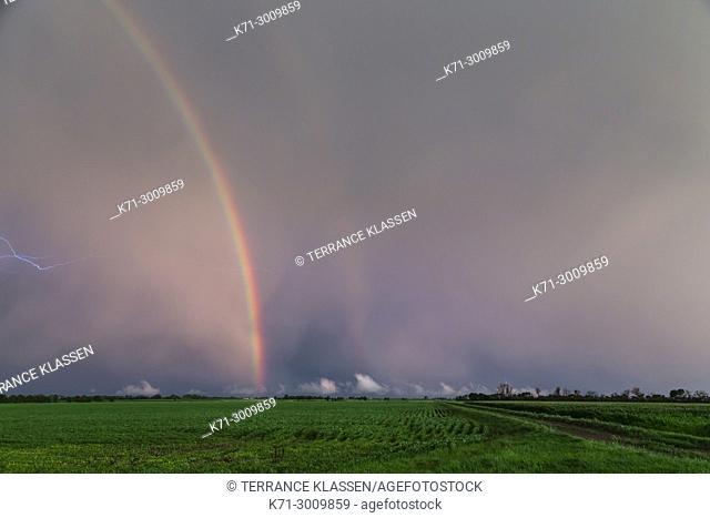 Rainbow on the prairies near Winkler, Manitoba, Canada