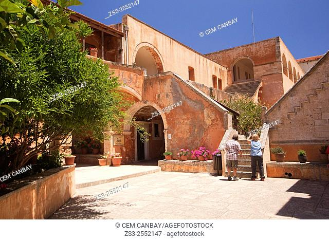 Tourist couple visiting the Agia Triada Monastery, Akrotiri Peninsula, Crete, Greek Islands, Greece, Europe