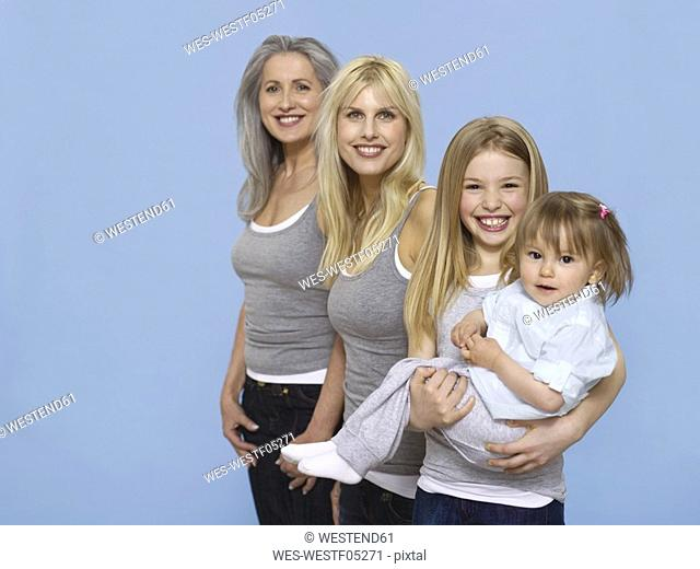 Senior woman with daughter and grand children, portrait