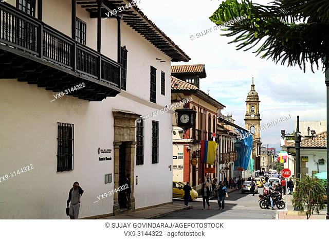 Bogota, Colombia - January 27, 2017: Looking down Calle, or translated into English, Street, 11 in La Candelaria. To the left of the image is the entrance to...