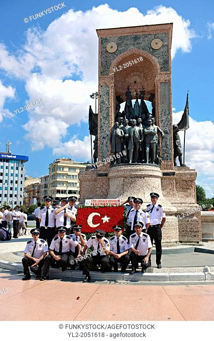 A Group of Frieman being photographed infront of the Monument of the Republic 1928 on Taksim Square, crafted by Pietro Canonica. Istanbul, Turkey