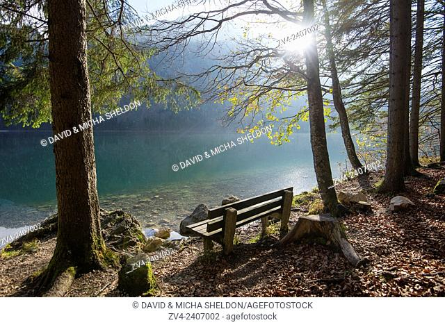 Landscape of a sitting accommodation beside a lake (Langbathsee) in autumn