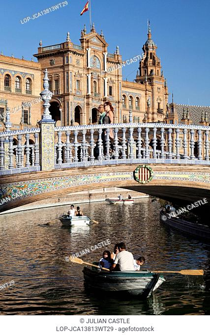 Spain, Andalucia, Seville. Boats on the stream at the Plaza de Espana