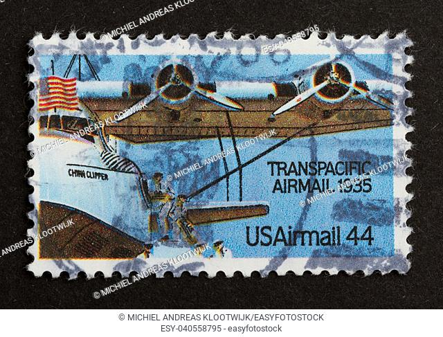 USA - CIRCA 1975: Stamp printed in the USA shows a airplane from the Transpacidic Airmail 1935, circa 1975