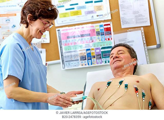 Nurse preparing patient for electrocardiogram, Ambulatory Lezo, Gipuzkoa, Basque Country, Spain