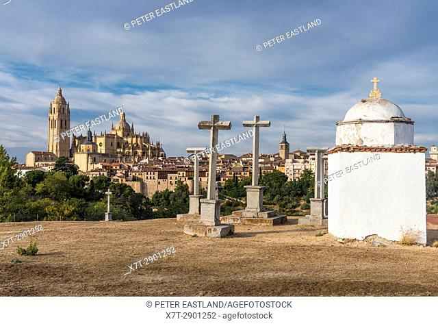 The city of Segovia and its late Gpthic Cathedral, seen from the Ermita de la Piedad and its stone crosses, Segovia, Central Spain