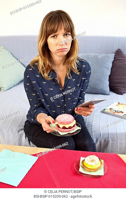 Woman using her phone before eating