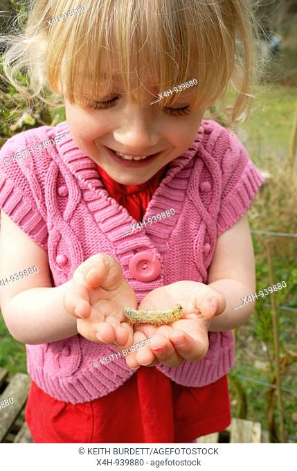 Young girl with a flower from a Willow tree, Pussy Willow, Wales