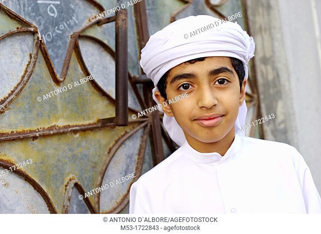 cute little boy outside his home in ras al-khaimah old town  ras al-khaimah  united arab emirates  middle east