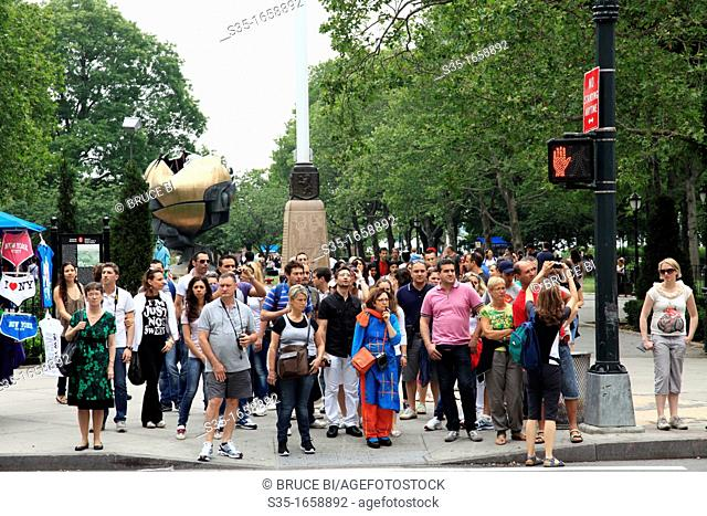 Visitors waiting for traffic light in downtown Manhattan  New York City  USA