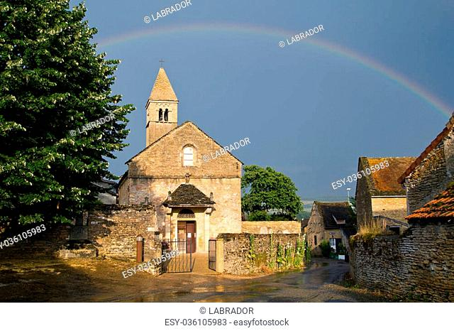 Church with a rainbow of Taize in Burgundy. France