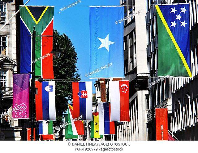 Flags of the world displayed in Jermyn Street near Piccadilly Circus in the heart of London, England, during the 2012 Olympics period