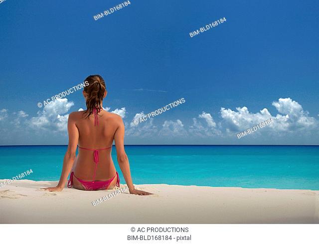Caucasian woman relaxing on beach