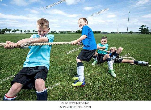 Young soccer team practicing Tug-of-war strength