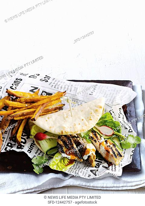 Butter chicken naan-wich with fries