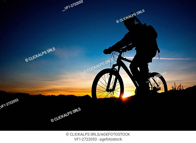 Silhouette of a biker in Valtellina, Lombardy Italy Europe