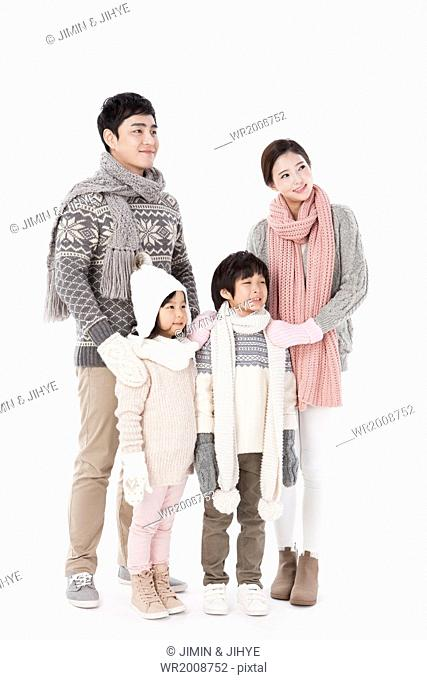 a family posing in winter outfits