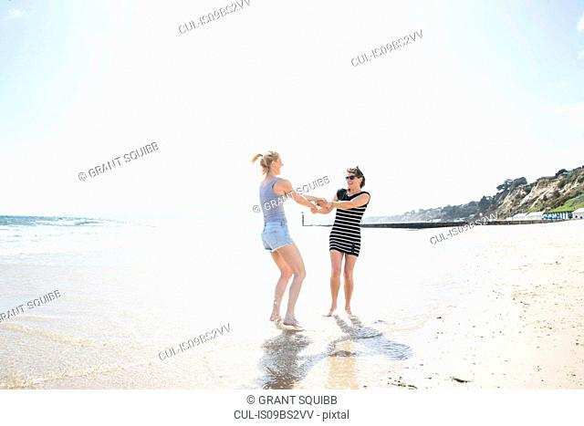 Sisters enjoying themselves on beach