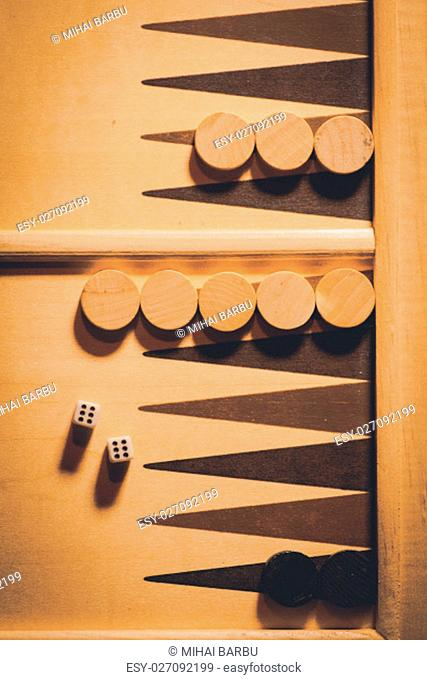 Backgammon board with double six dice, shot from above