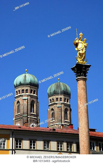 Mariensaeule column, golden figure of madonna on Marienplatz Square, in the back the two towers of the Frauenkirche Church, historic city centre, Munich
