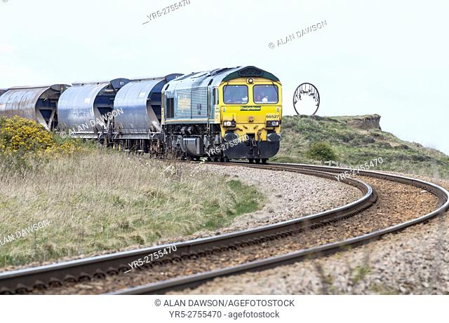 Freight train on some of the highest cliffs in England between Saltburn and Boulby on the North Yorkshire coast. United Kingdom