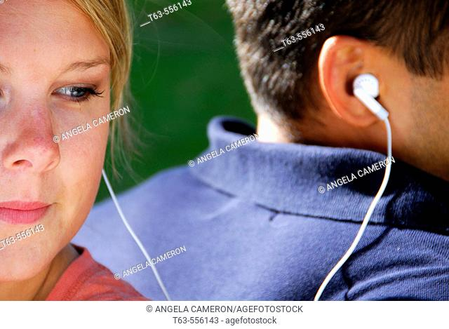male and female listening to music together