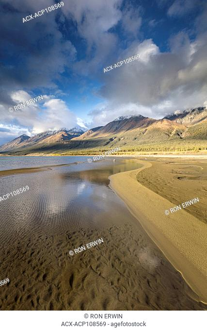 Snow topped mountains reflected in Kluane Lake in Kluane National Park and Reserve, Yukon, Canada