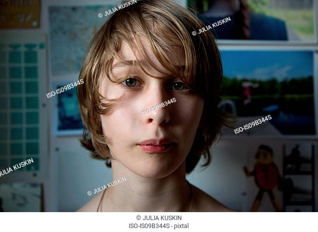 Portrait of young boy at home