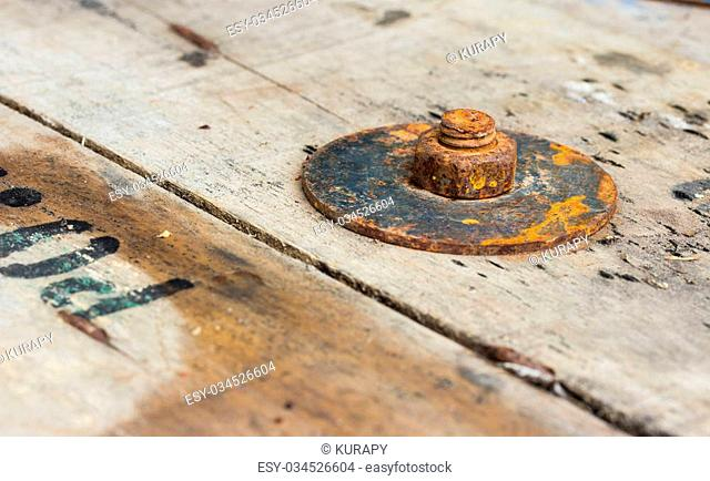 rusty nuts on wood background