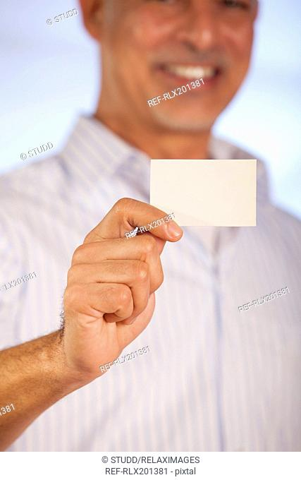 Senior businessman holding card presenting showing
