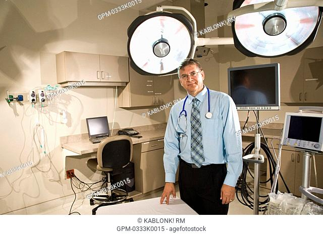 Portrait of doctor with stethoscope in hospital room with surgical lights