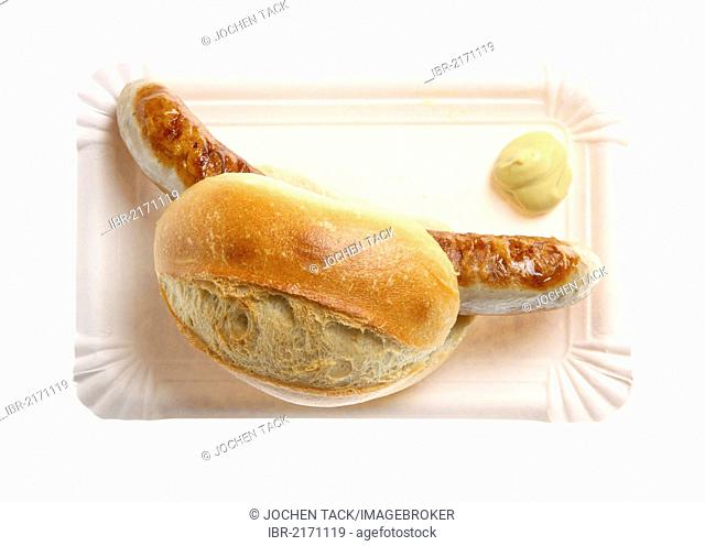 Fast food, grilled sausage in a bun with mustard