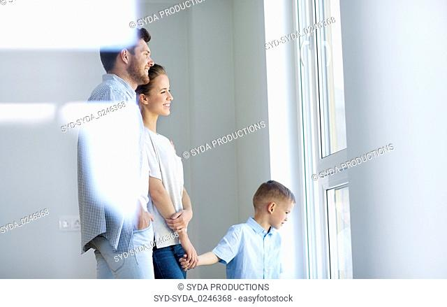 happy family with child at new home or apartment