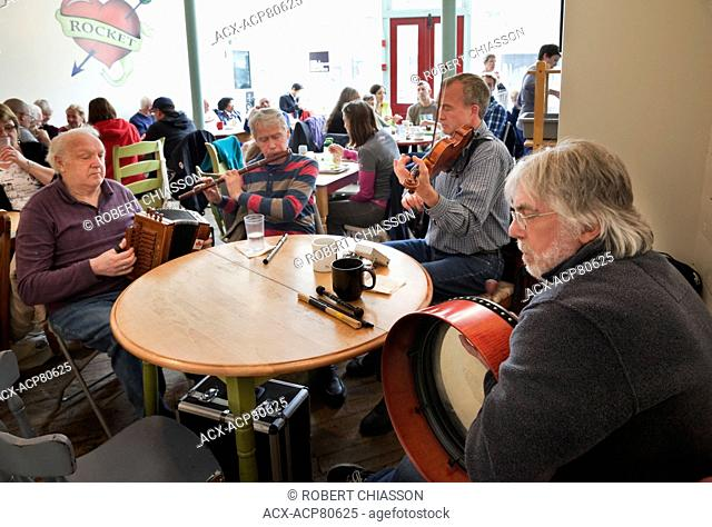 Stan Picket and the Rocket Players playing informally at St. John's Rocket Bakery and Fresh Food during a weekly lunchtime event called Tuneful Tuesdays