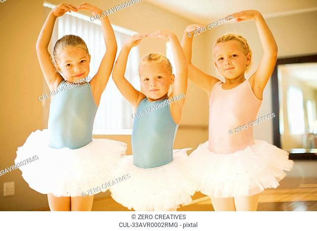 Girls in ballet costumes posing