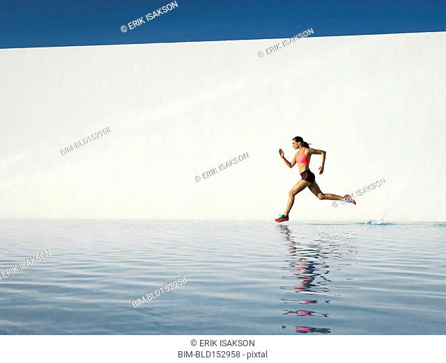 Caucasian woman running on water surface