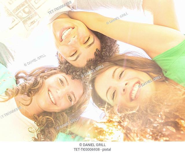 Portrait of friends (14-15) looking down