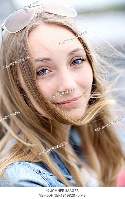 Smiling teenage girl looking at camera
