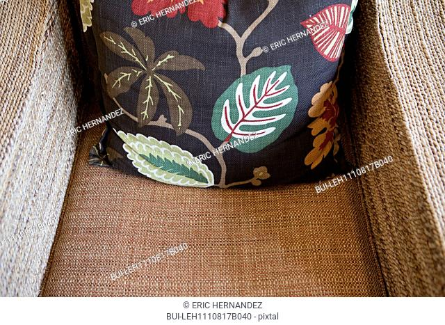 Close-up of a throw pillow on armchair at home; California; USA